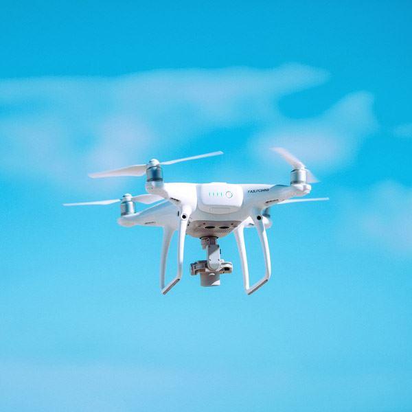 white drone in the sky