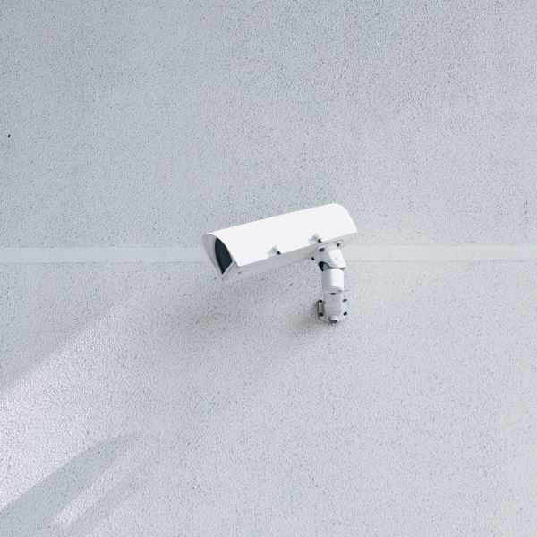 white security camera wall